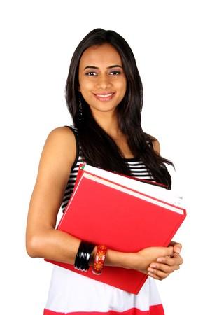 graduacion de universidad: Libros de explotaci�n de la joven adolescente. Aislado en un fondo blanco.  Foto de archivo
