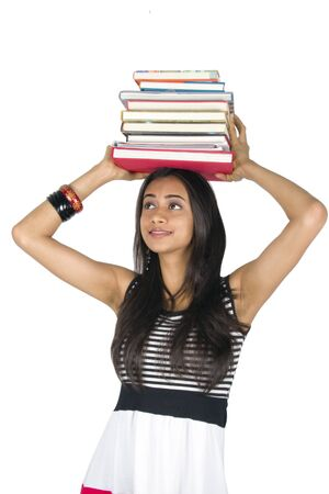 Young teenage girl holding books. Isolated on a white background. photo