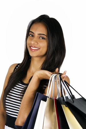 sexy young girls: Young Indian girl shopping. Isolated on a white background.