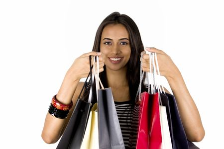 Young Indian girl shopping. Isolated on a white background. Stock Photo - 8131895