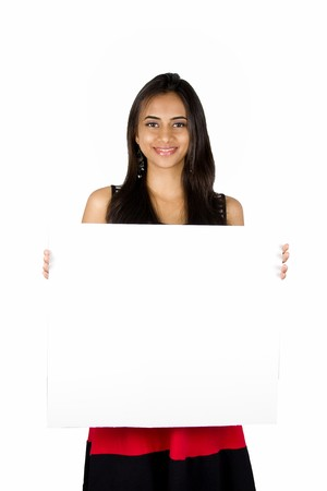 billboard posting: Beautiful Indian girl holding a white board.. Isolated on a white background. Stock Photo
