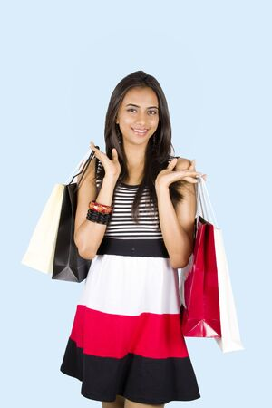 Young Indian girl shopping and smiling. Stock Photo - 8158570