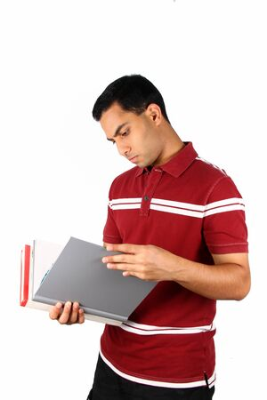 Young Indian student looking at a file. Isolated on a white background. photo