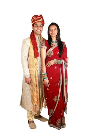 married together: Indian couple in traditional wear. Isolated on a white background.