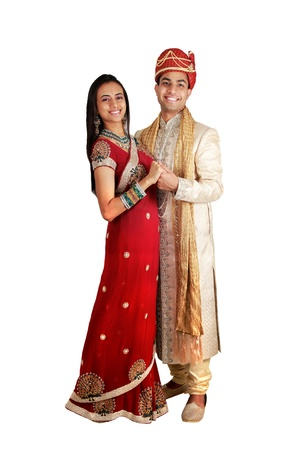 pakistani females: Indian couple in traditional wear. Isolated on a white background.