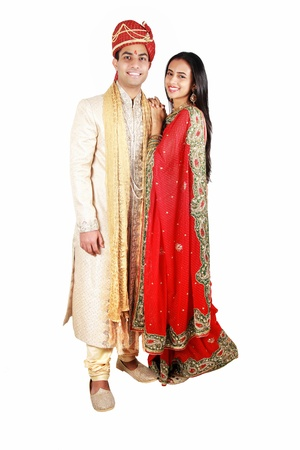 indian ethnicity: Indian couple in traditional wear. Isolated on a white background.