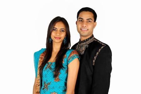Indian couple in traditional wear. Isolated on white. photo