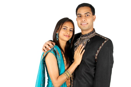 Indian couple in traditional wear. Isolated on white.