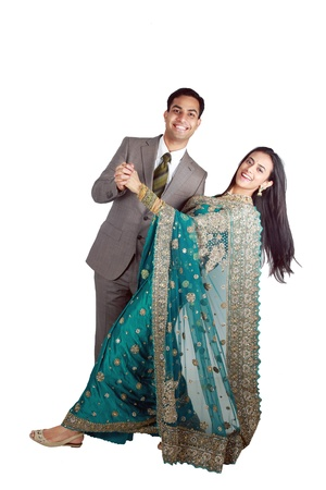 pakistani: Indian couple in traditional wear. Isolated on white background. Stock Photo