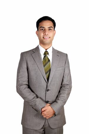 Indian business man smiling isolated on a white background. photo