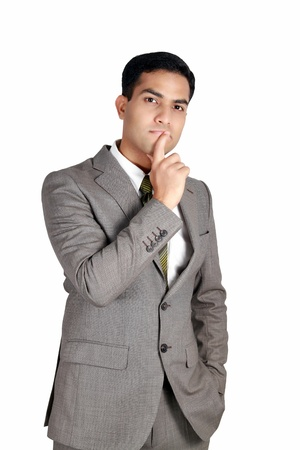 Indian business man in thinking pose. Isolated on a white background.
