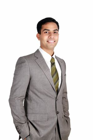 Indian business man smiling isolated on a white background.