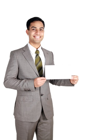 smartness: Indian business man holding a name card. Isolated on a white background.