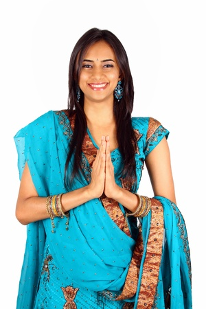 pakistani: Young Indian in a namaste(greeting) pose. Isolated on a white background.