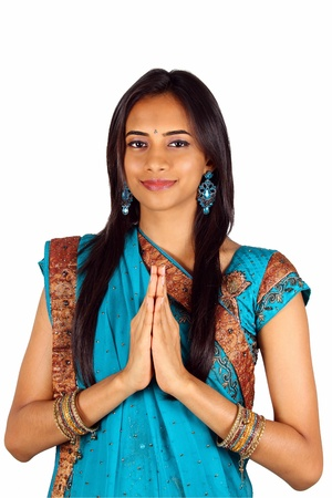 pakistani females: Young Indian in a namaste(greeting) pose. Isolated on a white background.