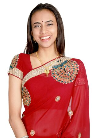 Young Indian girl in traditional clothing. Isolated on a white background.