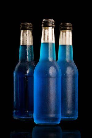 Blue bottle isolated on black background. photo