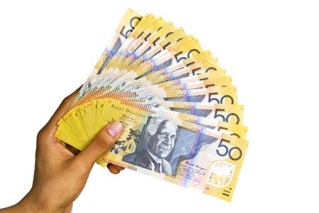 ganancias: Moneda australiana aislada sobre fondo blanco.
