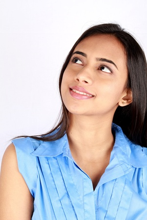Young thoughtful business woman over white background. Stock Photo
