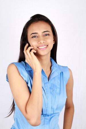 Portrait of young business woman on the phone. Stock Photo - 9628298