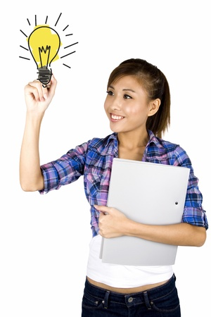 Young asian student drawing a bulb on a white background photo