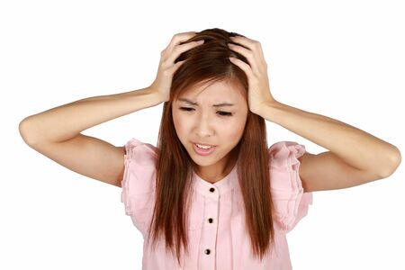 Young asian woman having a headache. Isolated on a white background.