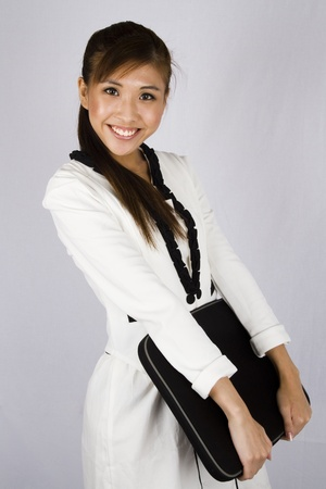 sales executive: Young asian businesswoman with laptop on white background.