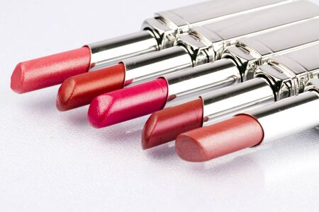 lipstick tube: Close up of lipstick on a white background.