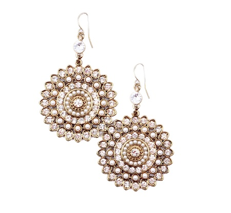 Pair of earrings isolated on the white background. photo