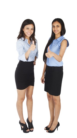multi racial groups: Young business women with thumbs up.