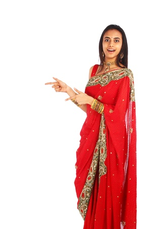 Young Indian girl in traditional clothing presenting.