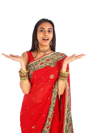 namaste: Young Indian girl in traditional clothing surprised. Stock Photo