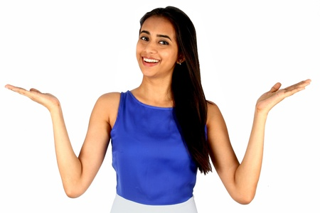 Young business woman over white background presenting  photo
