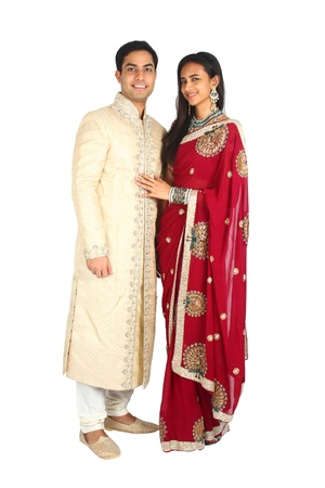 Indian couple in traditional wear  Isolated on a white background