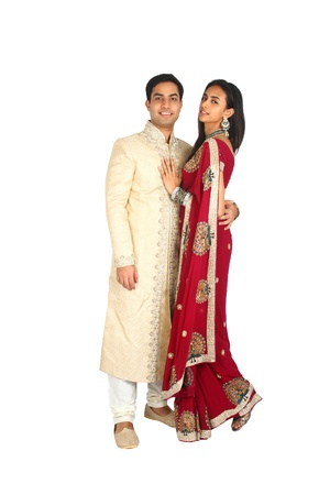 pakistani: Indian couple in traditional wear  Isolated on a white background