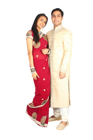 pakistani females: Indian couple in traditional wear  Isolated on a white background