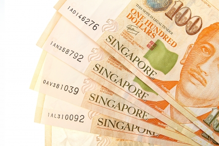 Singapore Dollars on a white background