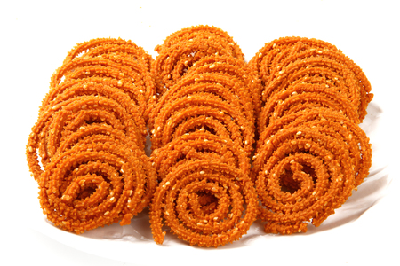 Traditional indian snack - chakali, isolated on white  photo