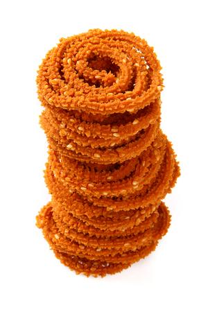 murukku: Traditional indian snack - chakali, isolated on white