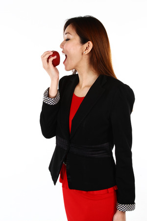 Businesswoman with an apple in her hand - healthy eating concept photo