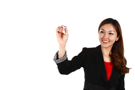 revenue: Asian businesswoman drawing graph, isolated on white background in suit  Stock Photo