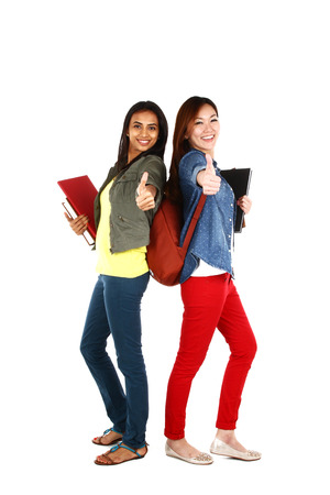 Portrait of young Asian students with thumbs up, isolated on white background photo