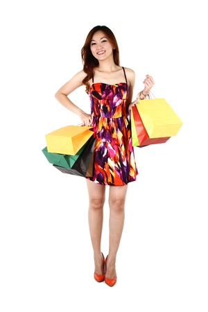 asian shopper: Asian woman with shopping bags, on a white background