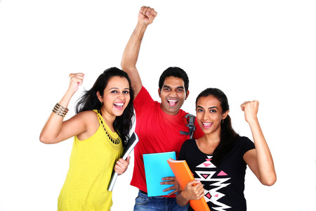 Group of excited people smiling and looking at camera with hands up celebrating success isolated on white background. photo