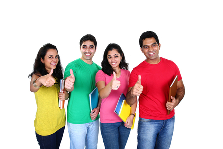 Group of friends smiling with thumb up denoting success, isolated on white background
