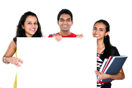Group of Indian friends displaying white placard for your text isolated on white background Stock Photo