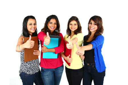Group of excited people smiling and looking at camera with hands up celebrating success isolated on white background.