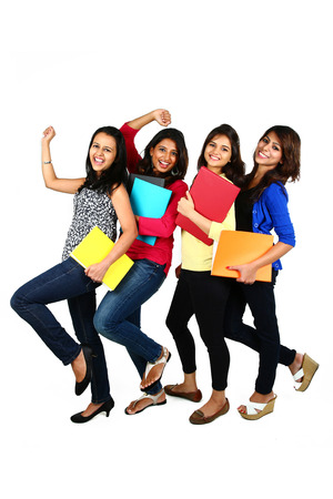 Group of smiling female friendsstudents, isolated on white background Stock Photo