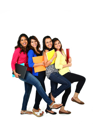 Group of smiling female friendsstudents, isolated on white background photo