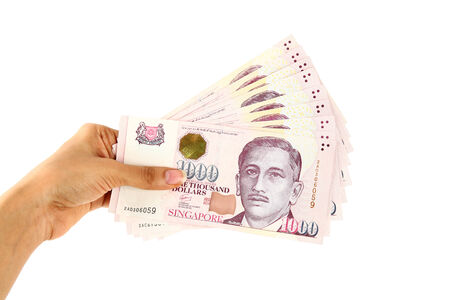Singapore currency isolated on white background.